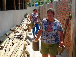 Our High School Students Help Rebuild the School